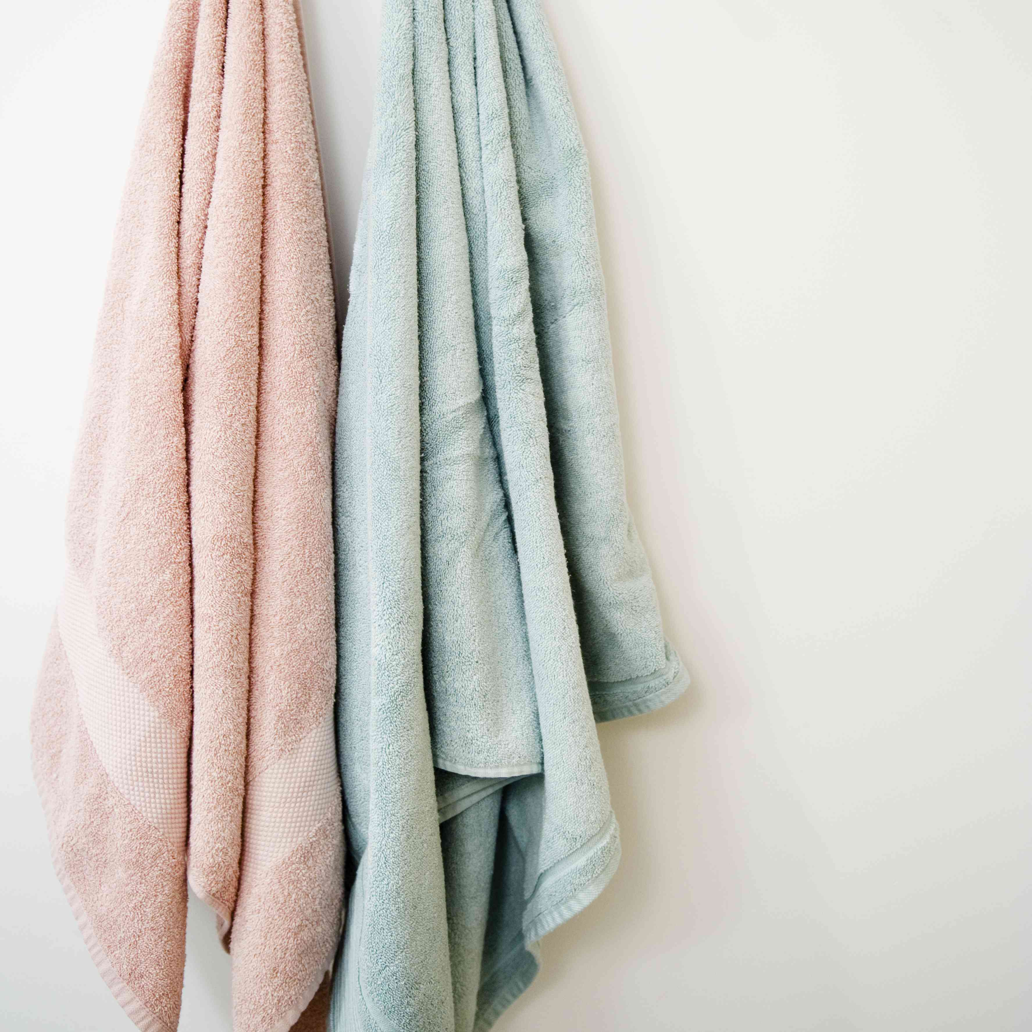 Towels hanging from wooden rack