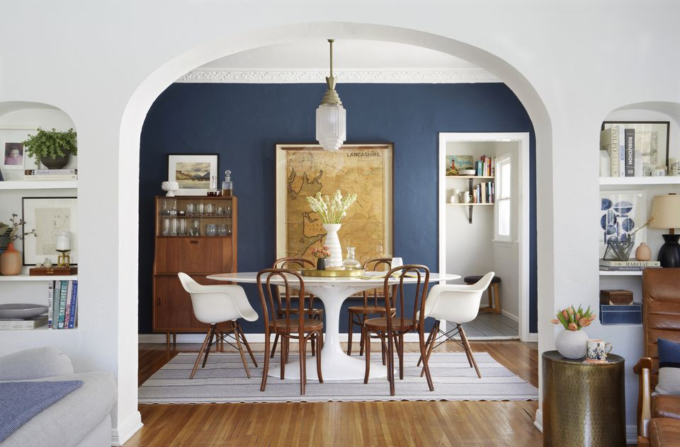 This dining room was painted in Stiffkey Blue by Farrow & Ball.