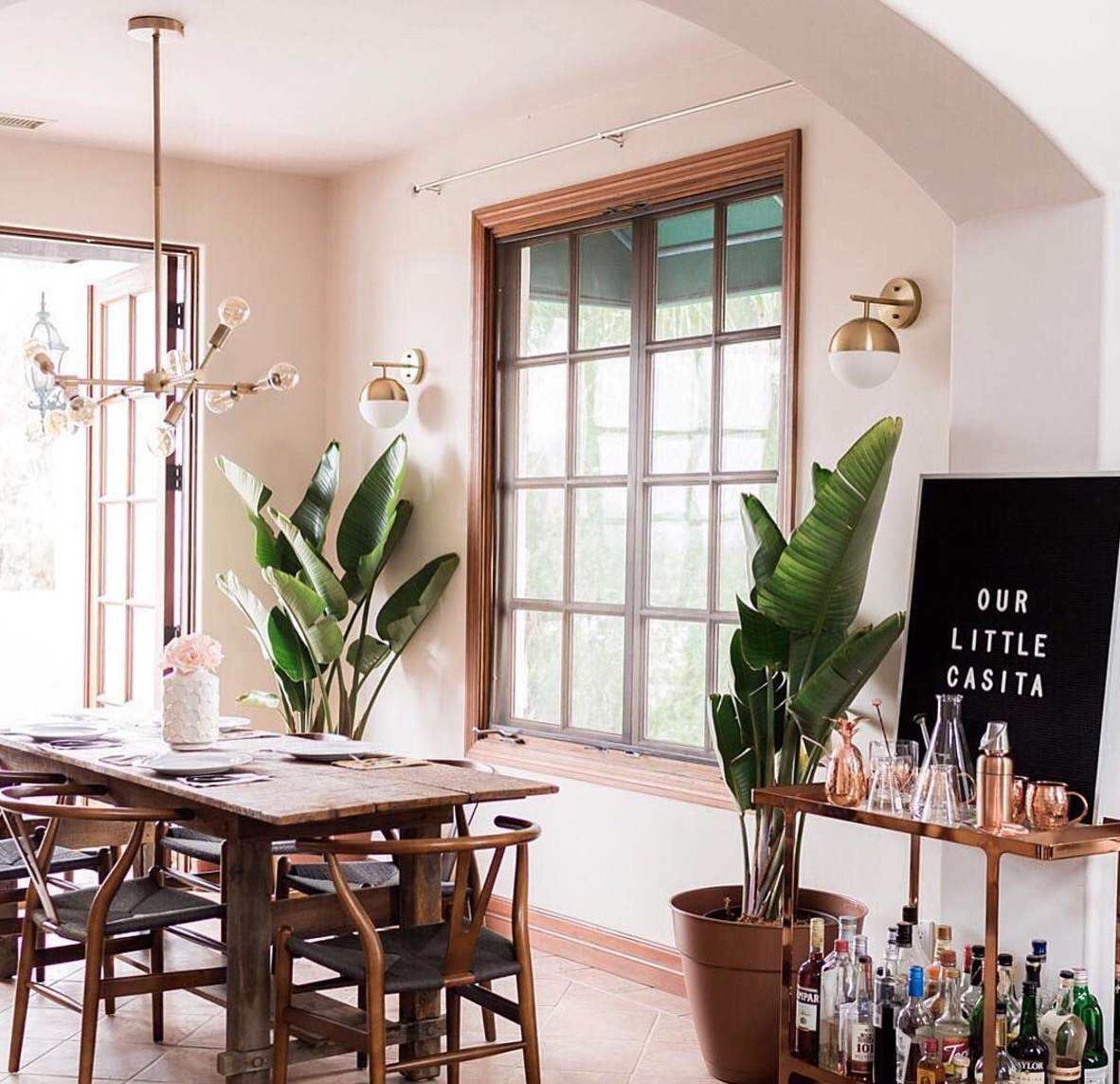 dining room with a bar cart and sign that says our little casita