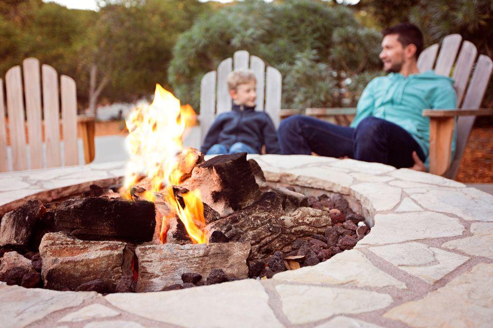 Family sitting near firepit