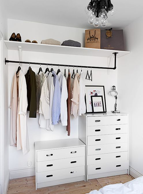 Two small dressers with a rod and a shelf