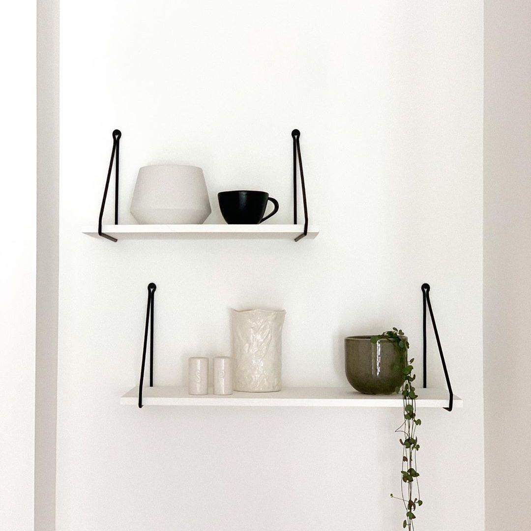 Hanging shelfs with white and black ceramics