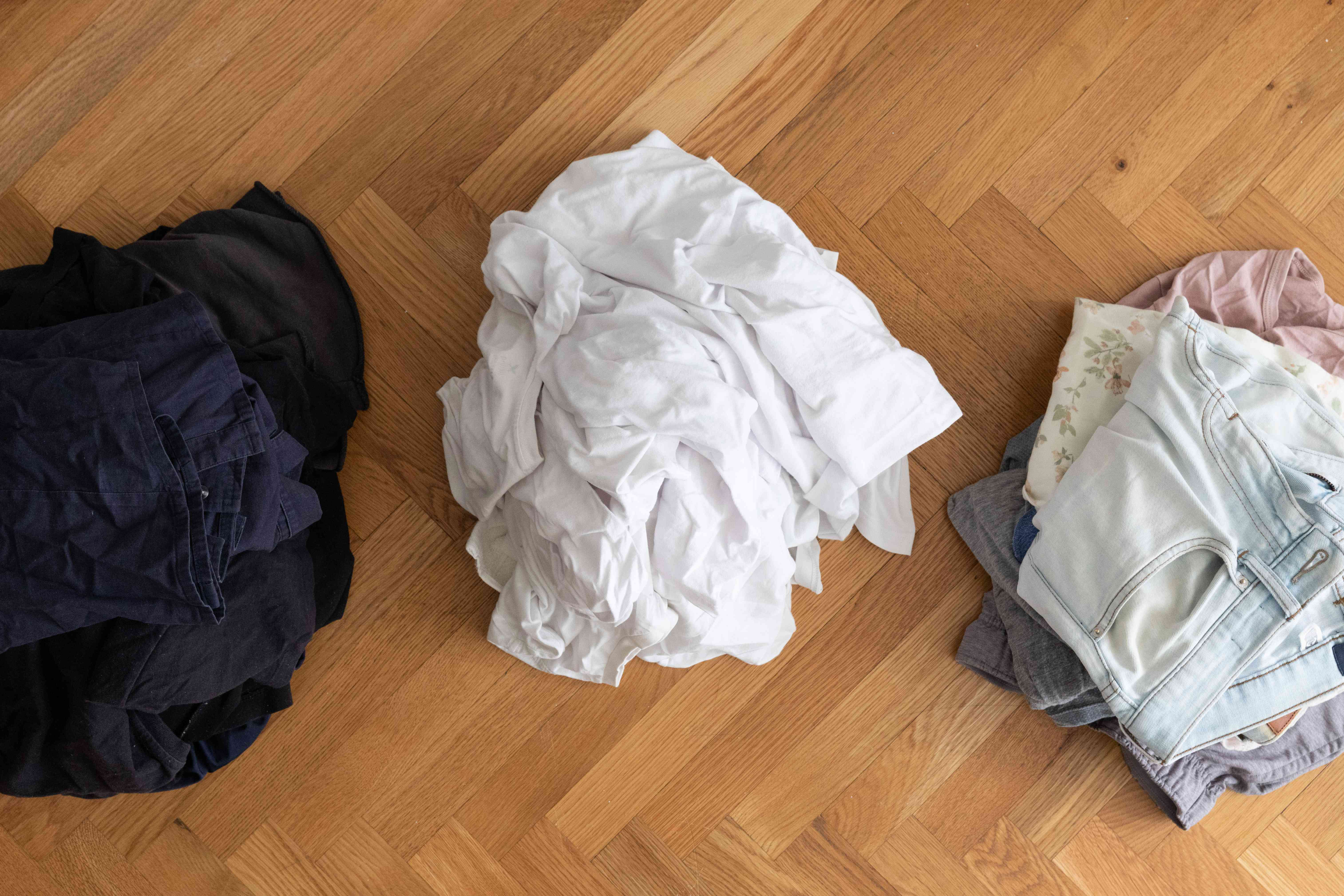 Dirty laundry clothes separated by color