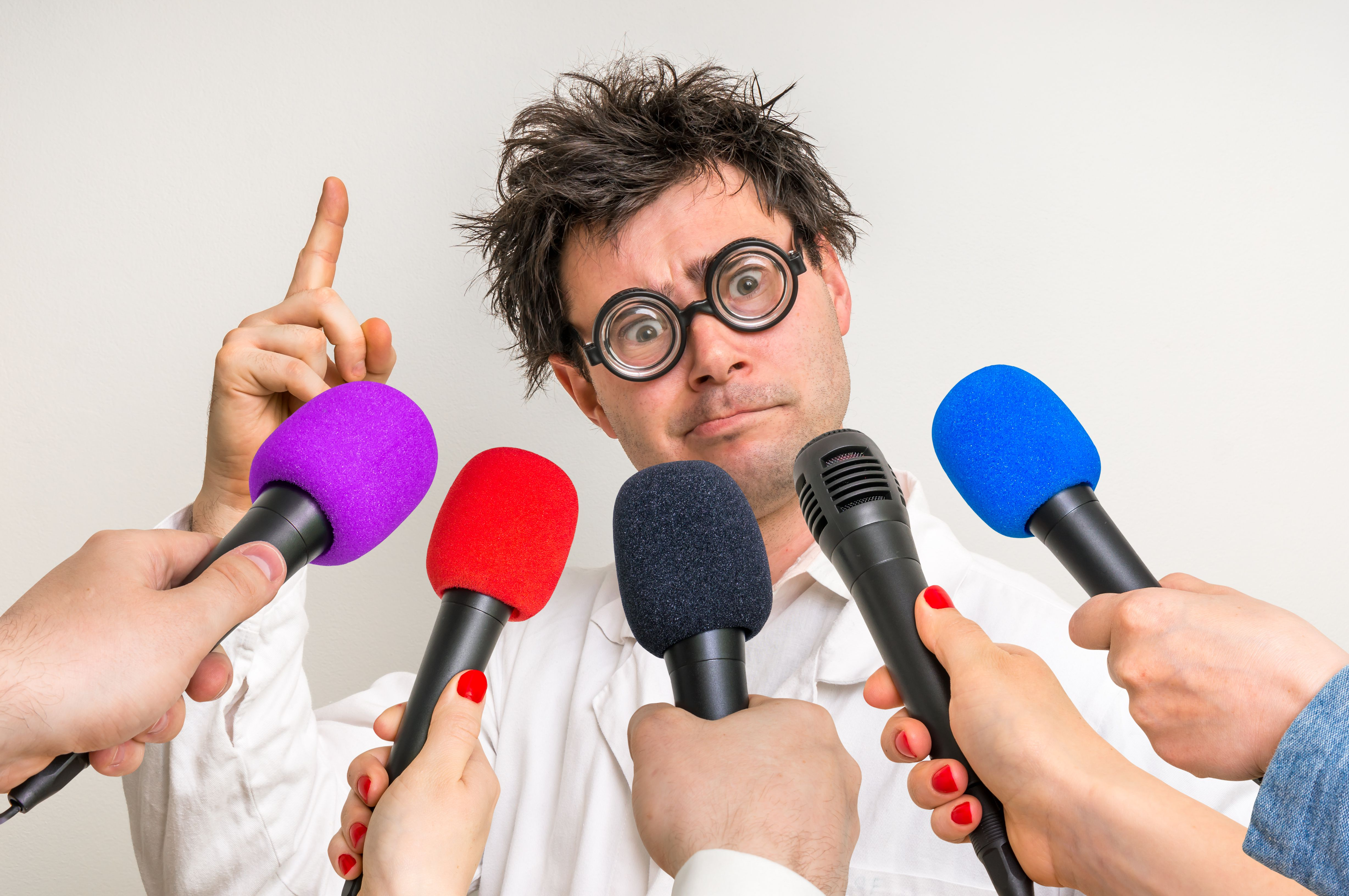 Reporters making interview with funny scientist