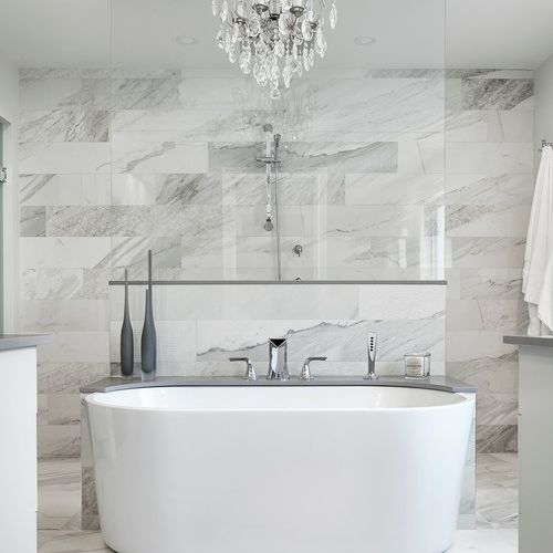 marble master bathroom with chandelier