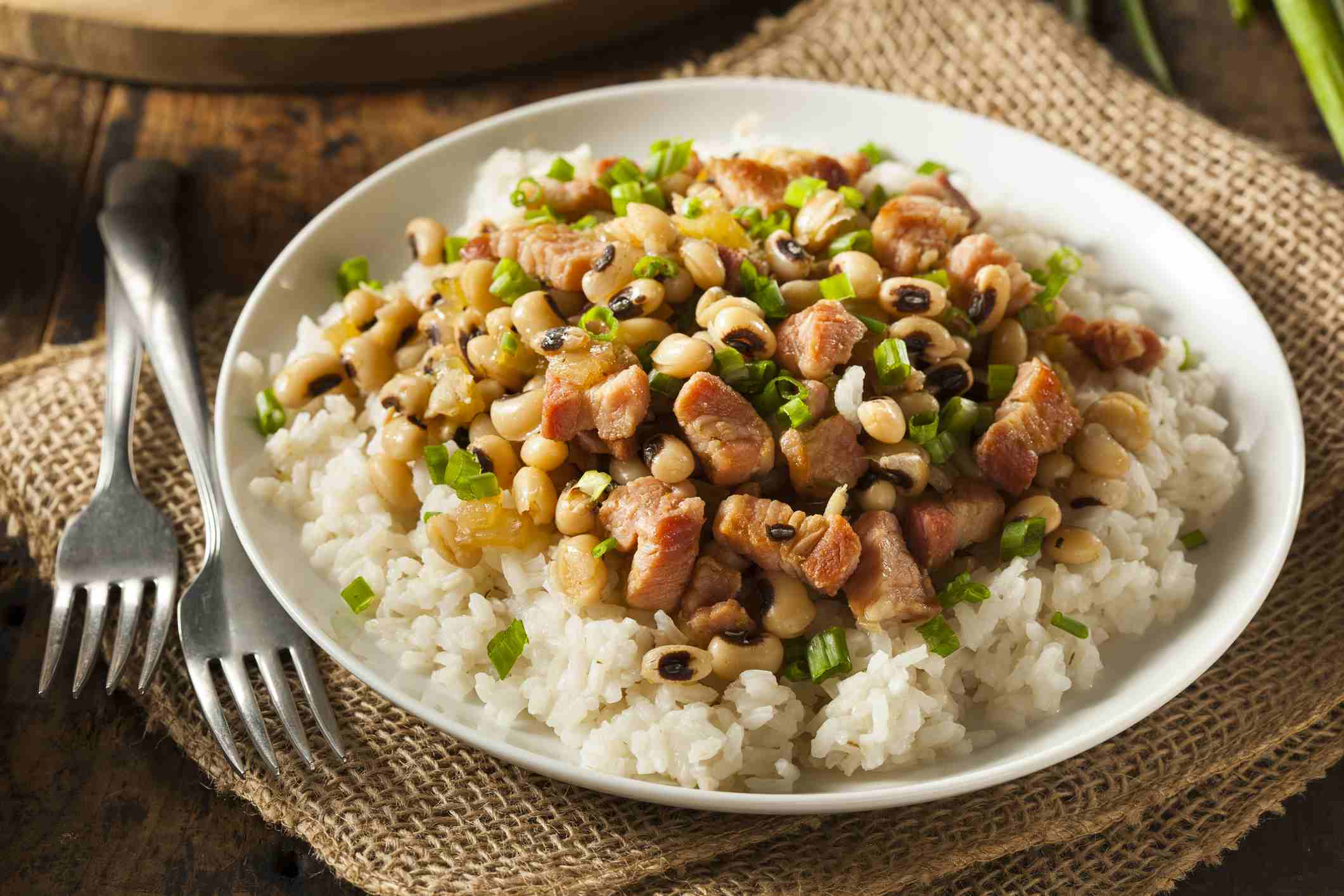 A picture of hoppin john served over rice.