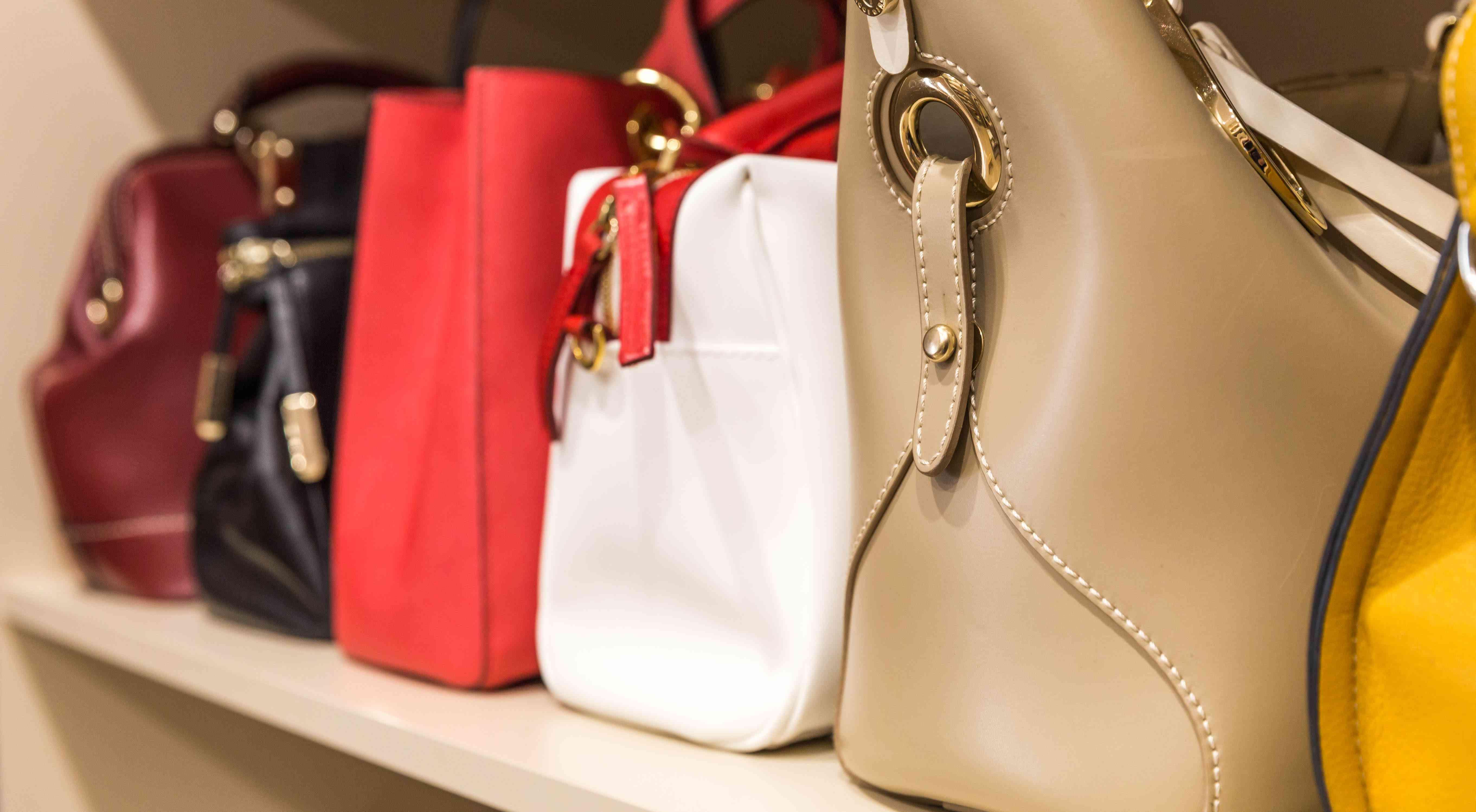 collection of handbags on a shelf