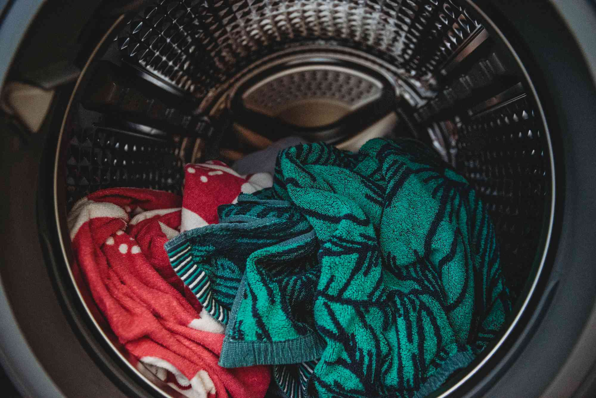 loading towels into the washer