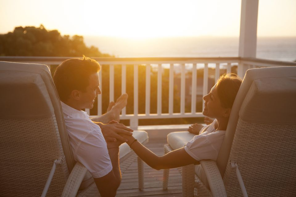Young Couple on the porch of their vacation home