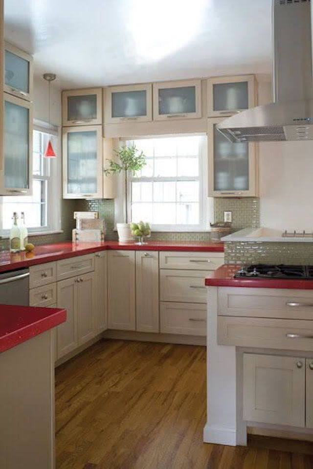 white kitchen with bright red countertops
