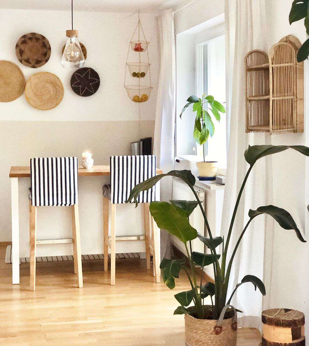 Boho style breakfast bar with baskets on the wall