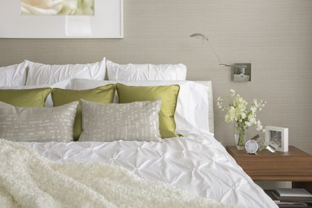 Contemporary Bedroom With Textured Bedding And Throw Pillows