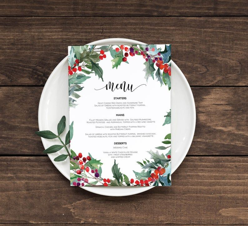 A menu and plate on a wooden table
