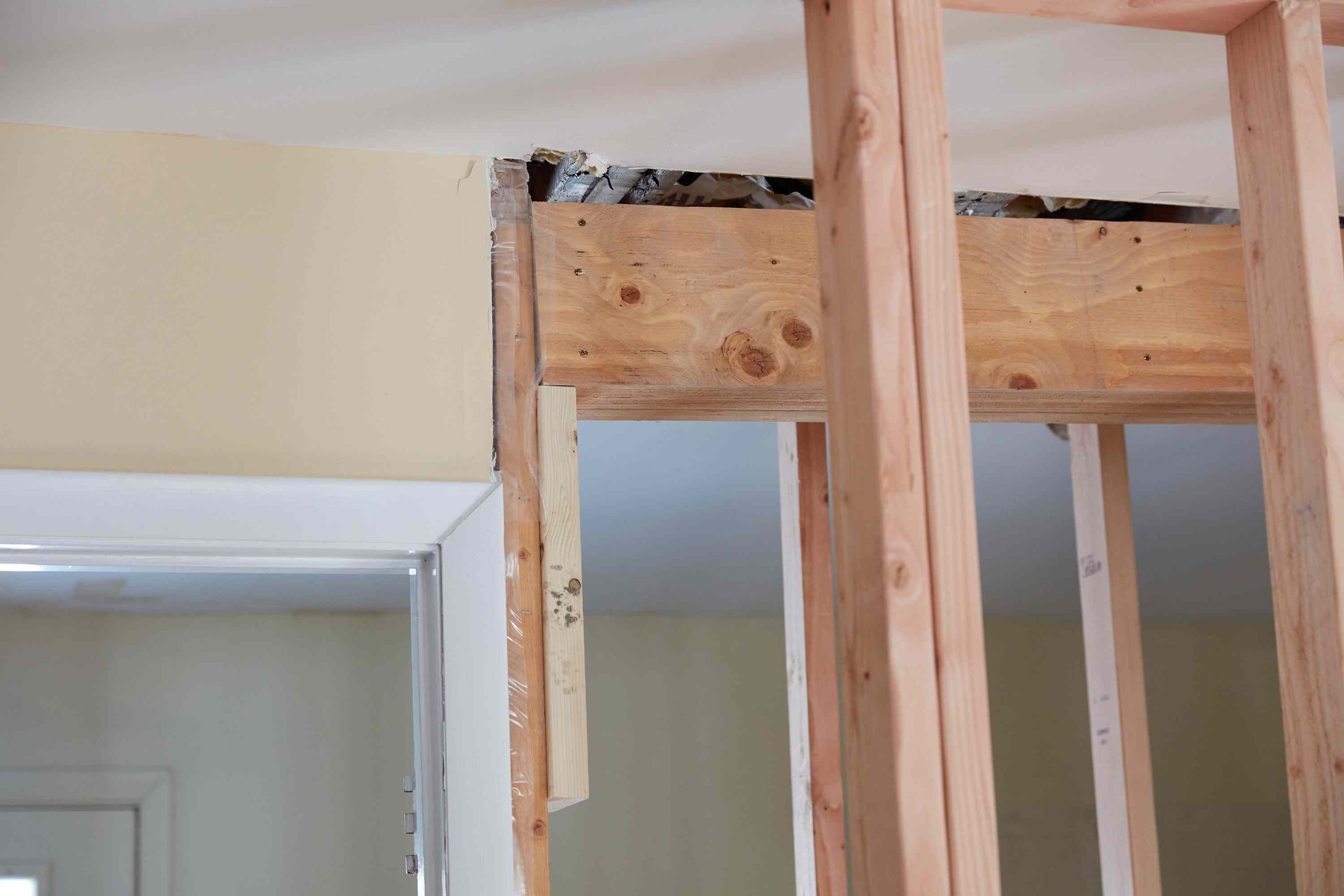 Temporary beam ledger attached under load bearing wall structure