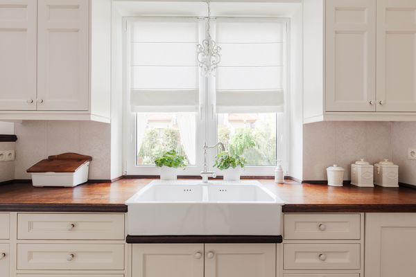 White cabinets and brown countertops in a traditional style kitchen