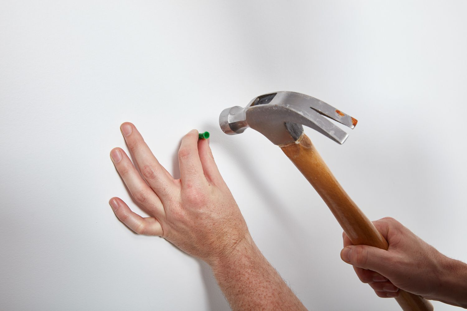 Tap the anchor in pre-drilled hole with a mallet or hammer