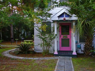 Pink front door of beach cottage