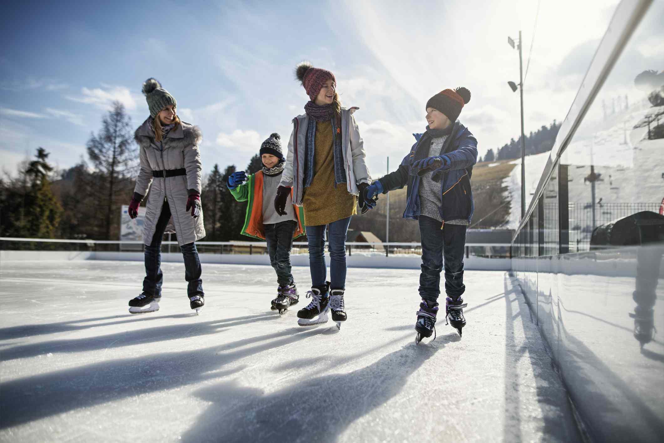 Family enjoying ice-skating together
