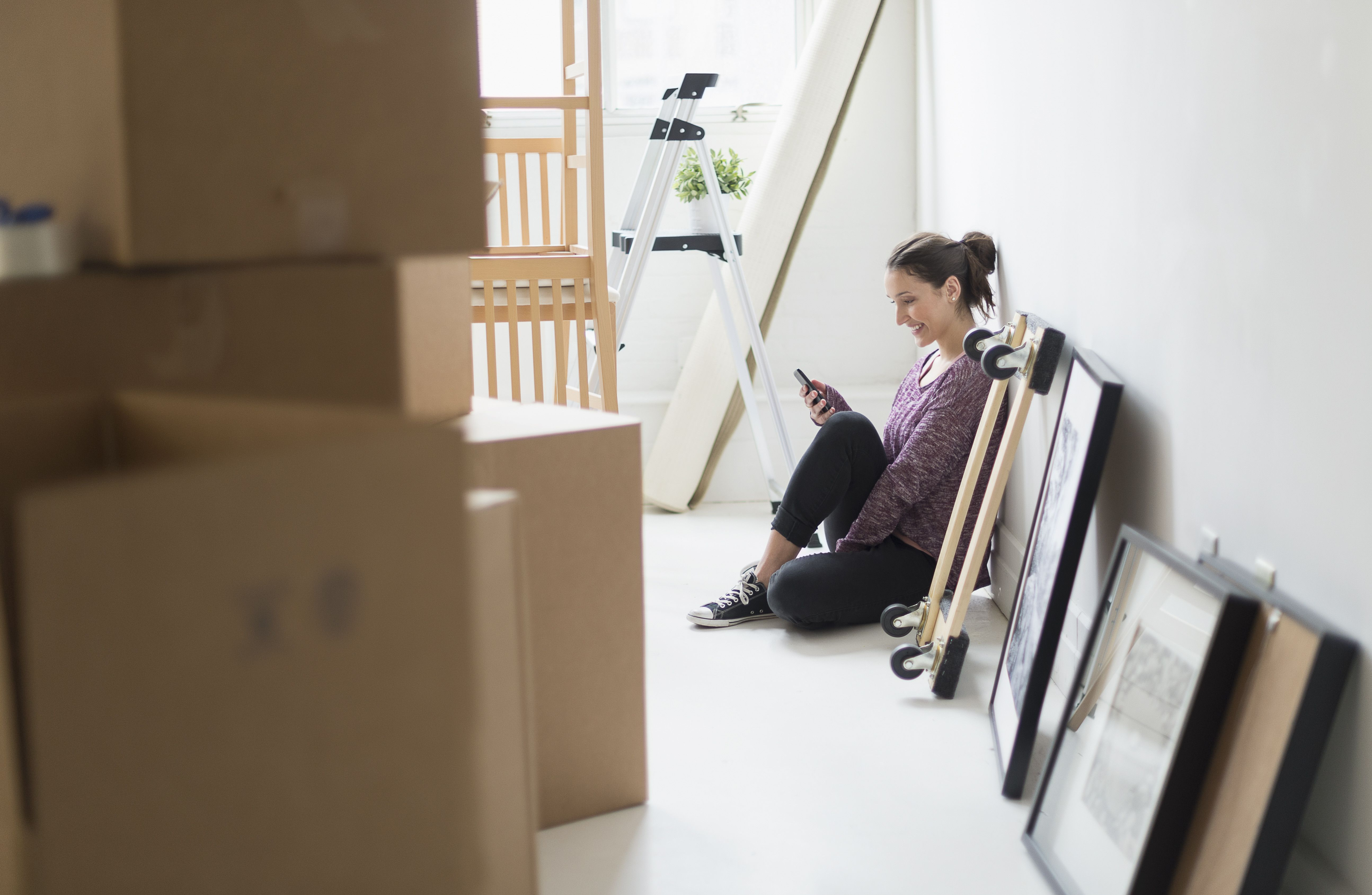 Young woman moving into new flat