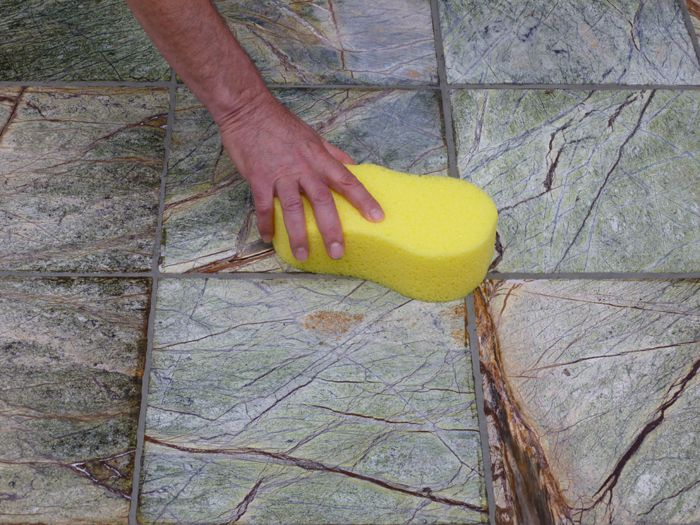 cleaning tile with a grout sponge