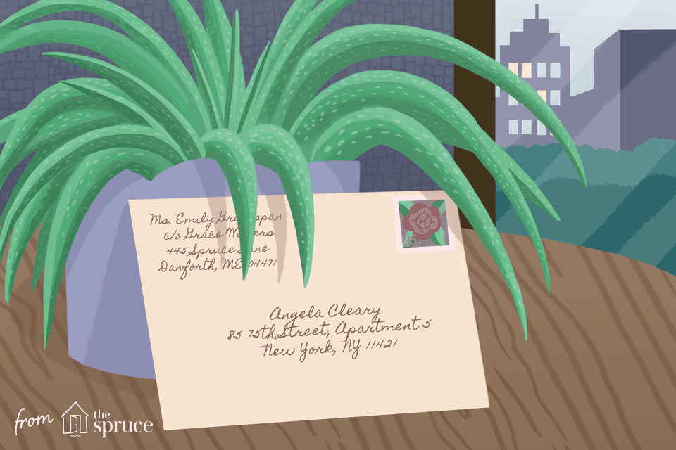 A card leaning against a plant