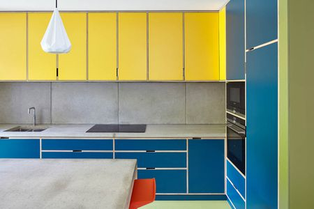 Yellow And Blue Kitchen With Concrete Countertops
