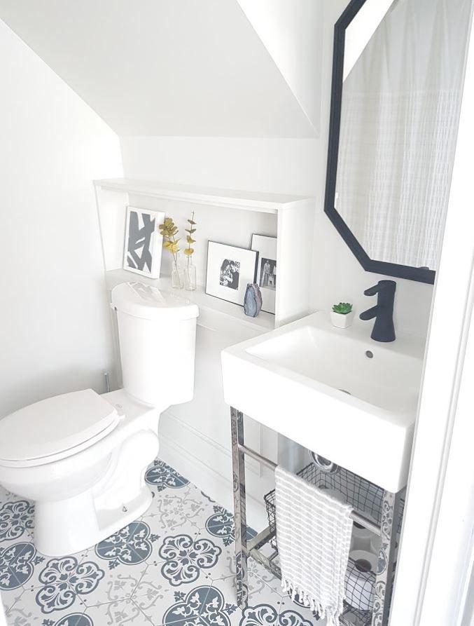 Small bathroom with gray tiled floor.