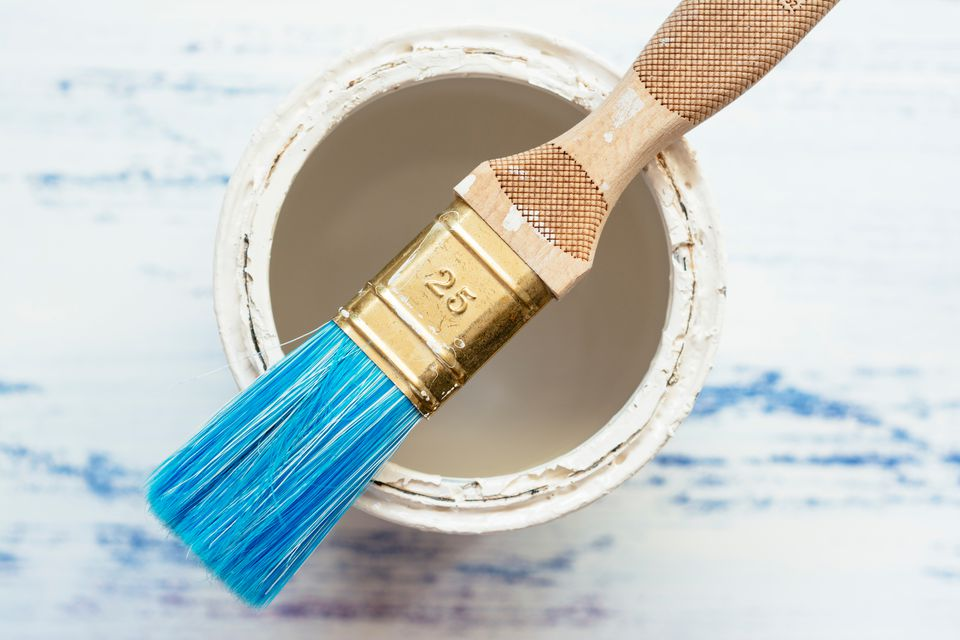 Paintbrush on paint can
