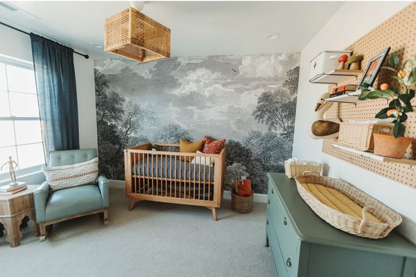 nursery with teal green color scheme, nature mural on accent wall