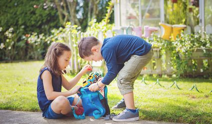 Young kids playing with toys outside
