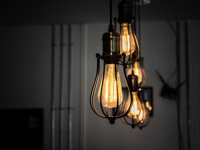 Illuminated pendant lights with incandescent amber bulbs hanging at home