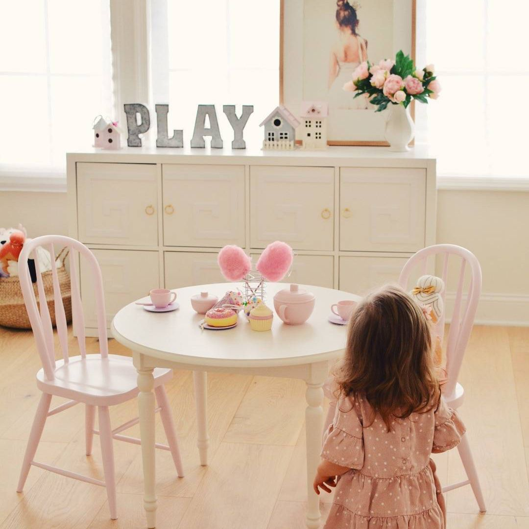 Pale pink and white playroom set for a tea party