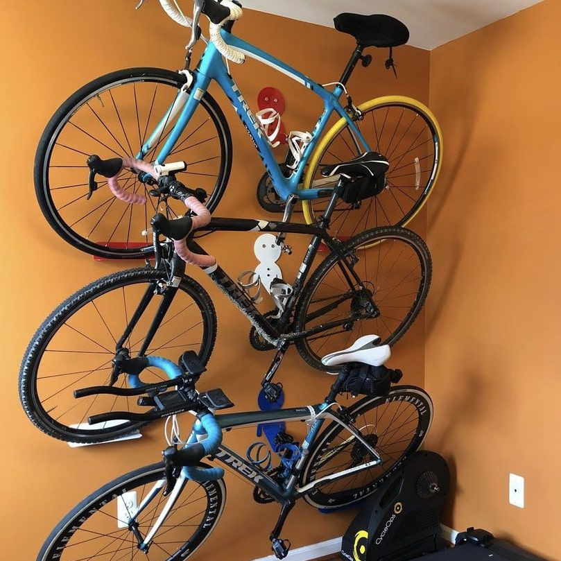 three bikes hanging in a row