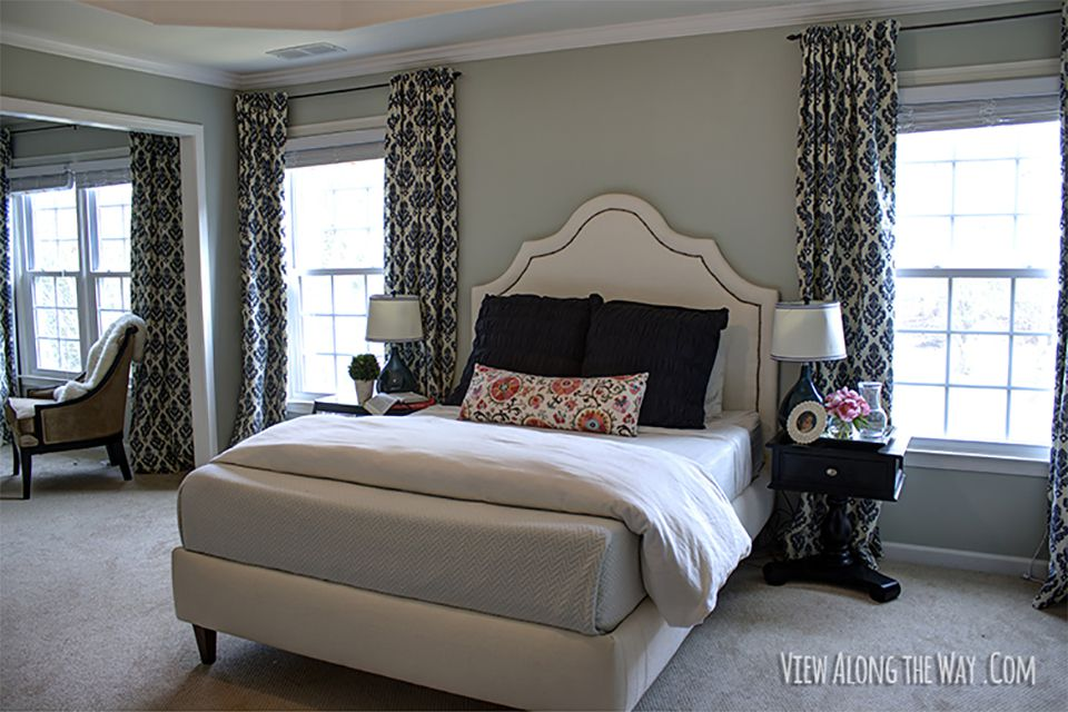 An upholstered bed in a bedroom