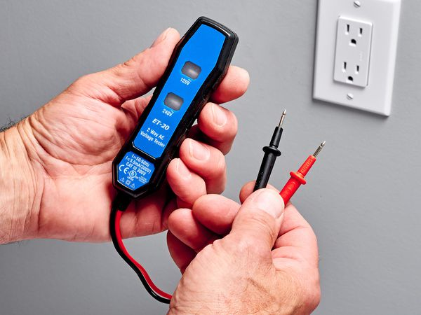 Neon circuit tester testing electrical outlet for grounding