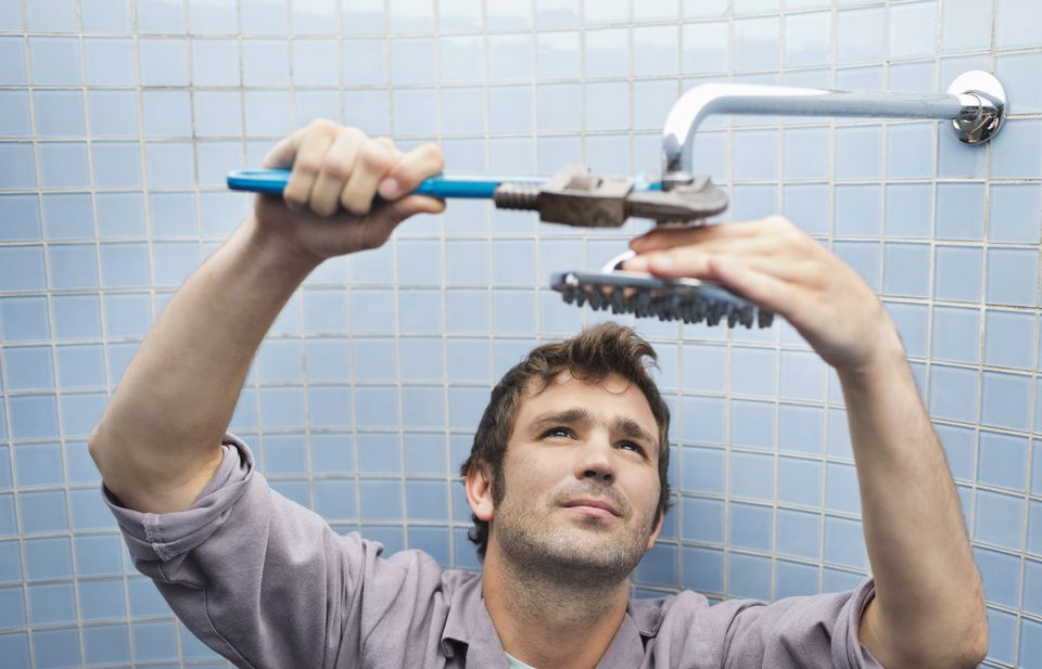 man installing shower head