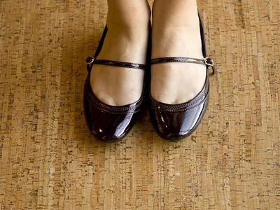 woman's feet on a cork floor