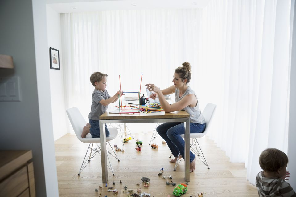 Mother and son playing at kitchen table