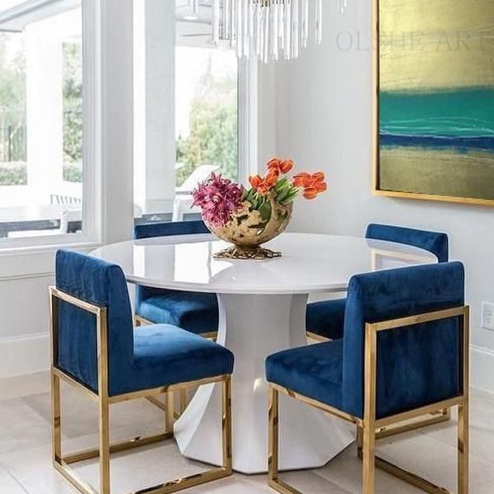 Dining room with blue and gold chairs