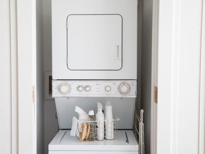 Stacked Whirlpool washer and dryer with laundry materials in between