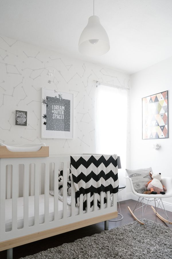 Modern, white nursery with understated star theme
