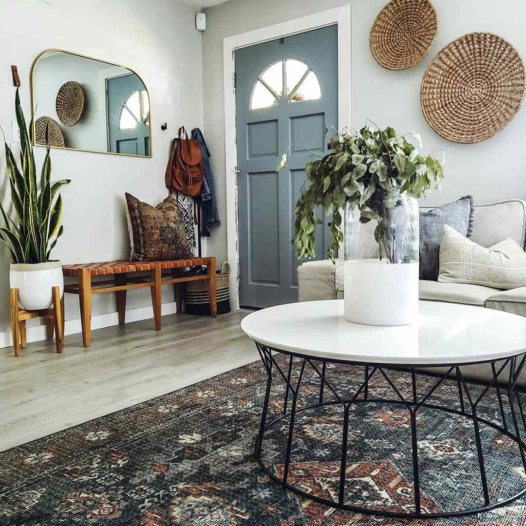 Living room with boho accessories and a blue rug