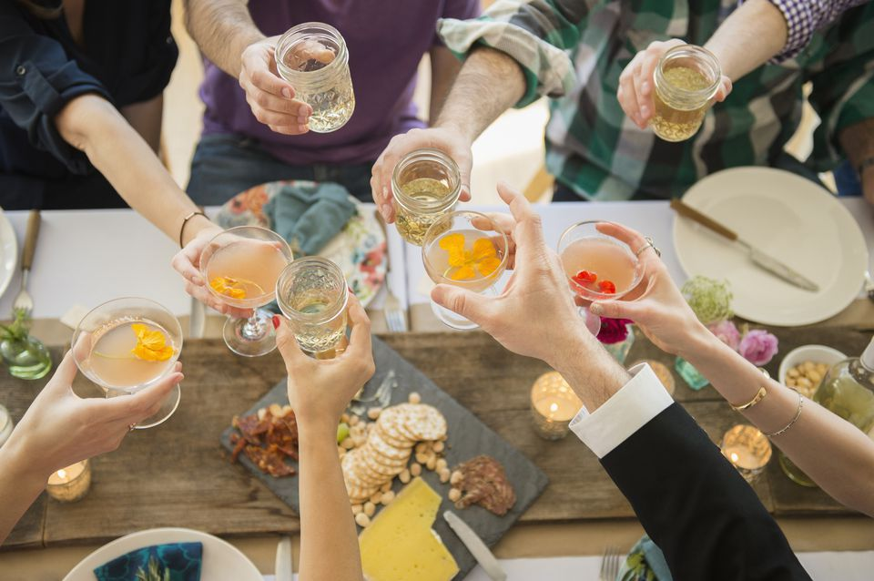 young people toasting at a cocktail party