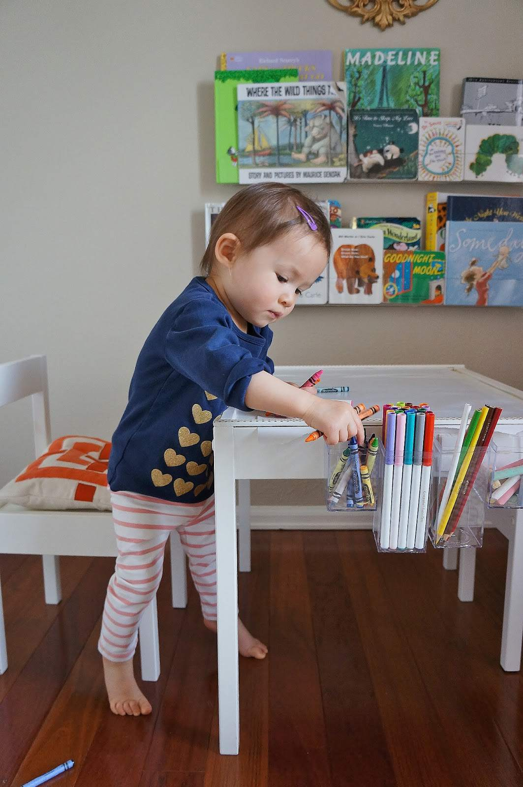 Child coloring on a small drawing table made from an Ikea Latt table set