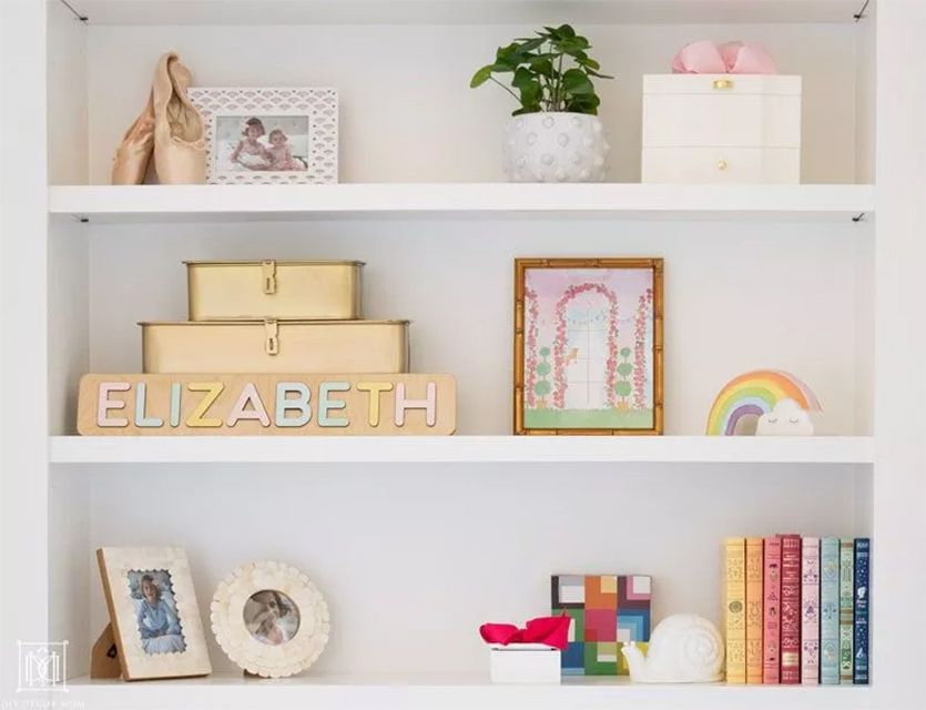 A close-up of decorated bookshelves