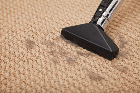 Close Up Of A Vacuum Cleaner Cleaning Carpet