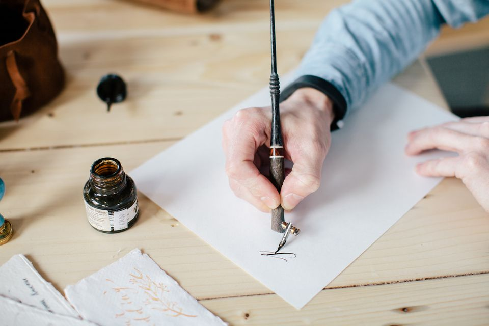 Man writing with calligraphy pen
