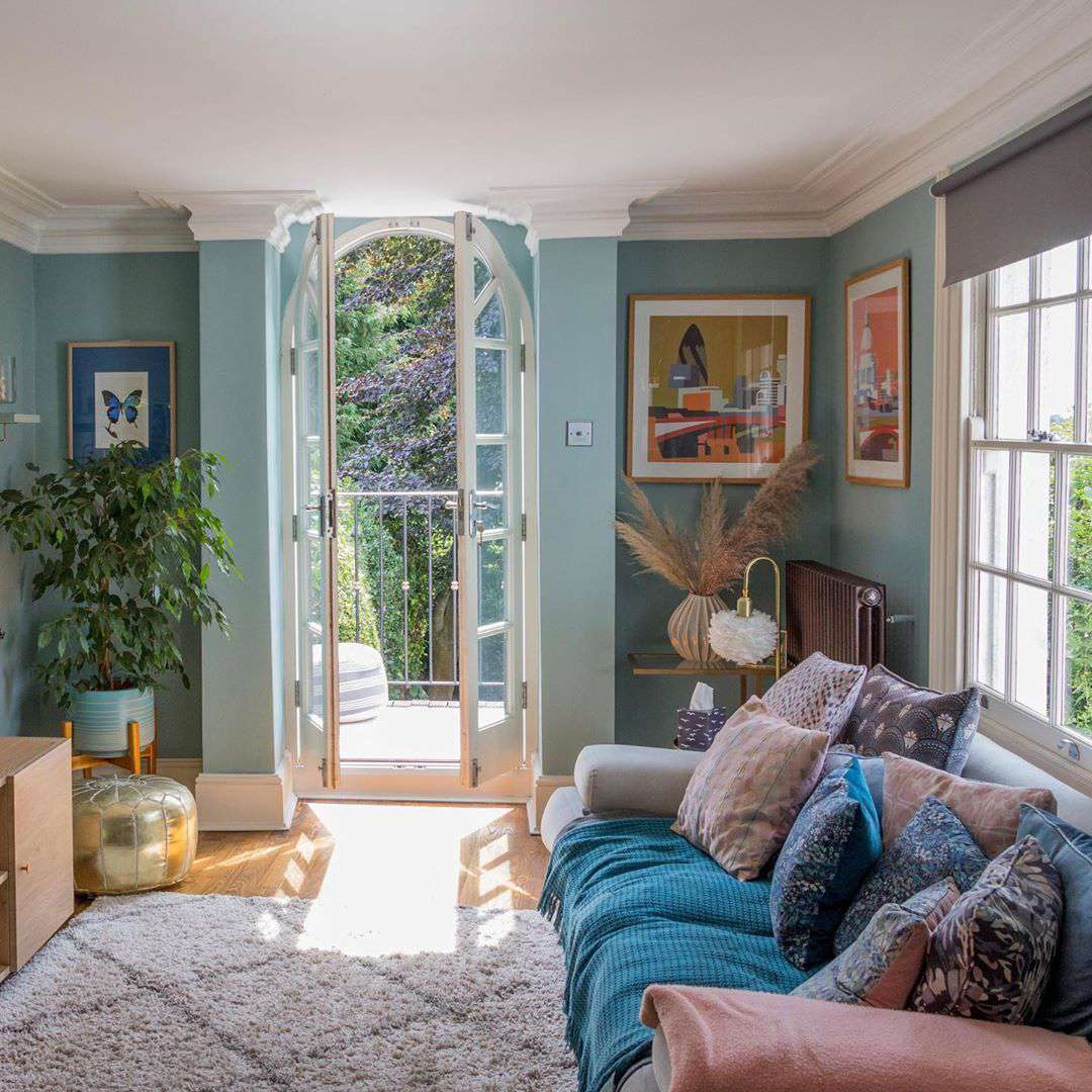 Family room with blue walls and light colors