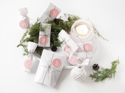 Homemade advent calendar - gifts with numbers on it and modern christmas decoration.