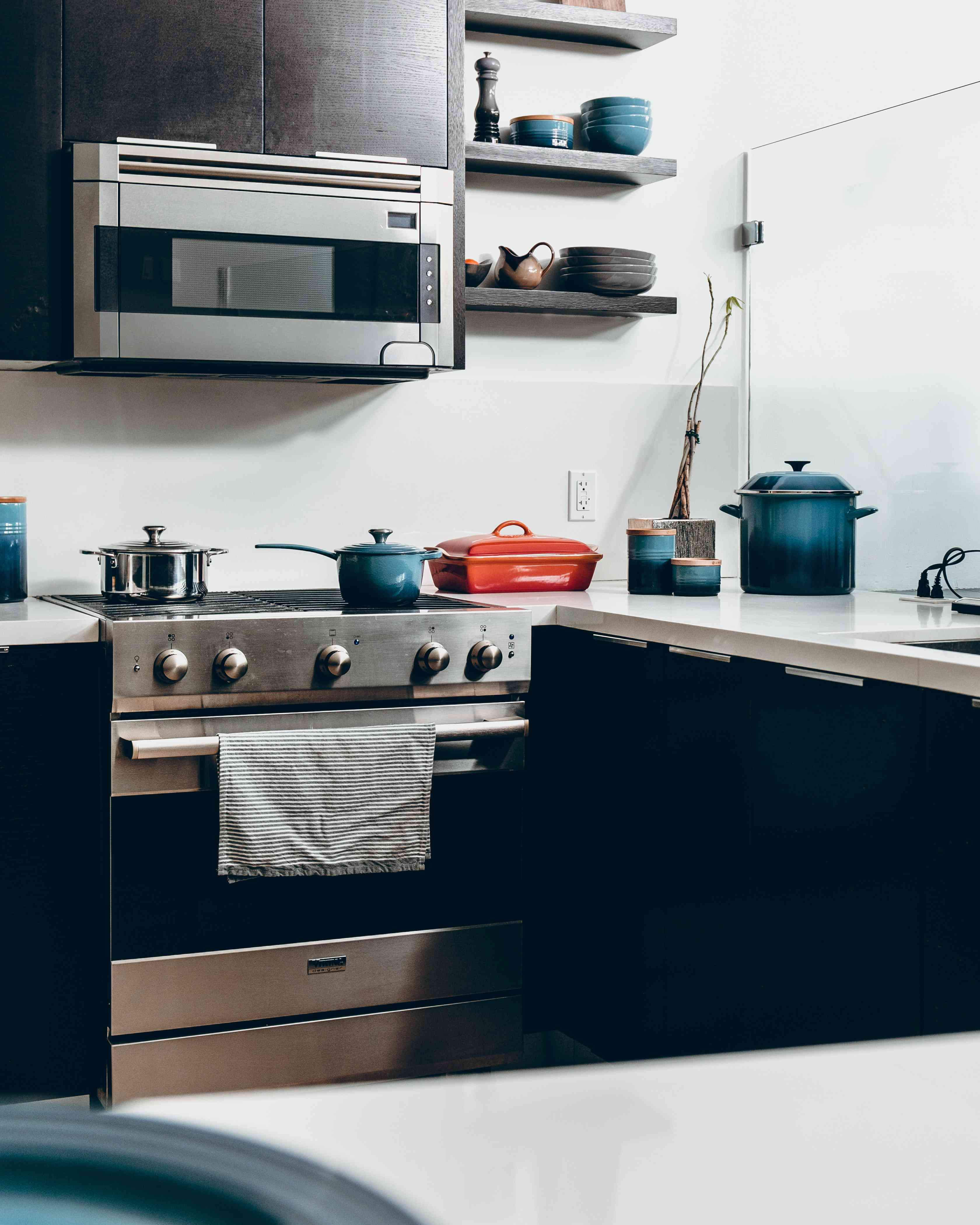 Oven in a kitchen with pots and pans